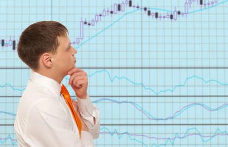 Stock trader looking at monitors Banco de Imagens