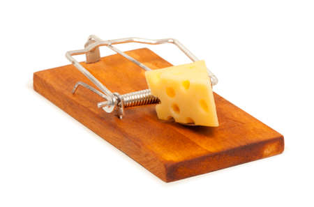 Mousetrap with piece of cheese isolated on white Stock Photo