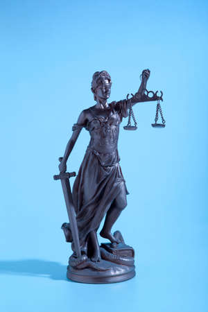 advocate: Symbol Justice.  Lady of Justice. Blue Light Stock Photo