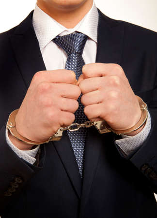 Arrested business man handcuffed hands. Close-up. Banco de Imagens - 39048988