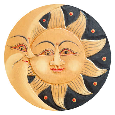 polychromatic: Sun and moon profiles, ancient carved wooden, isolated on a white background