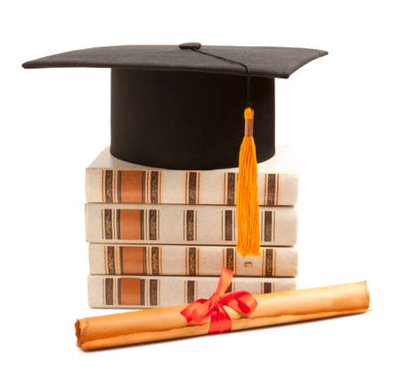 black cap: Graduation hat, book and diploma isolated on white