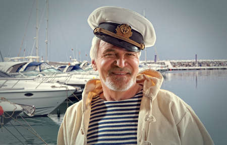 skipper: Captain. Happy sailor man on ocean boat background Stock Photo