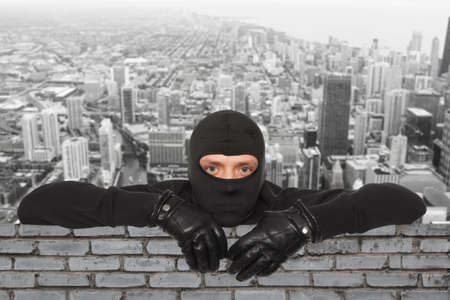 scammer: Roofers. Ninja against the backdrop of the city