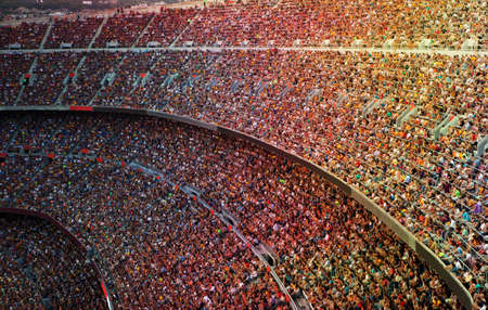 crowded: Fans at the big football stadium Stock Photo