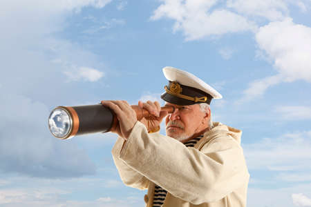 sailors: Captain looks through a telescope