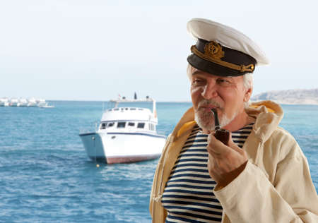 marine ship: Captain. Sailor man in marina port with boats background