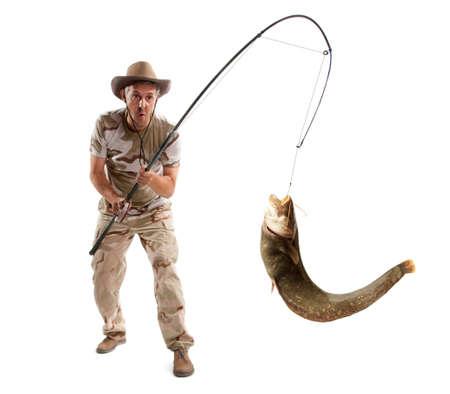 pecheur: Pêcheur avec grand poisson-chat de la rivière isolé sur blanc