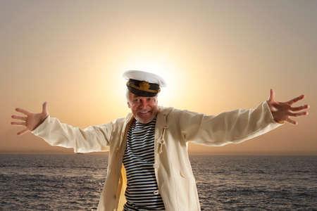 skipper: Captain. Happy sailor man on ocean background