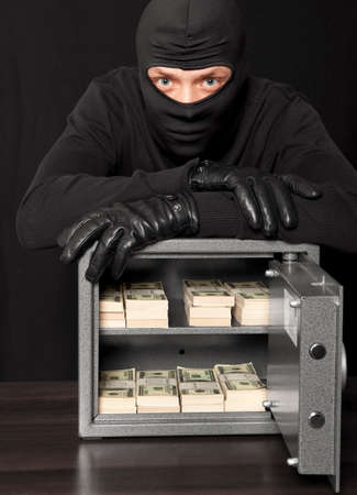 looter: Thief burglar stealing money during home safe codebreaking
