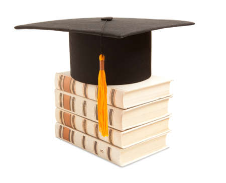 rewarded: Gortarboard and book, isolated on white