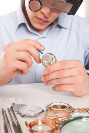 watchmaker: Watchmaker. Watch repair craftsman repairing watch