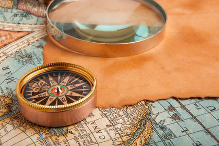 compass: Old compass on vintage retro map 1687 Stock Photo