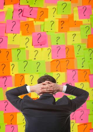 solves: Brainstorming. Businessman solves complex problem