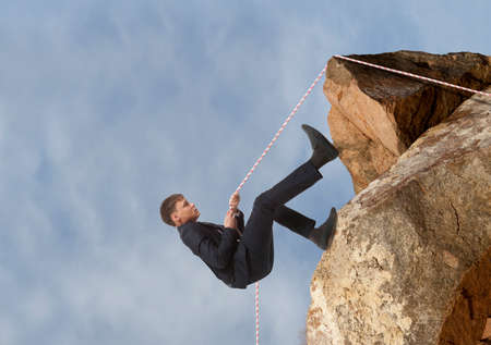 careerist: Businessman scaling a rock. Business concept