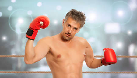 red gloves: Muscular boxer in red boxing gloves