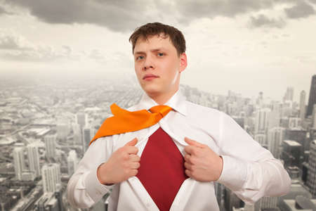 undress: Businessman showing the superhero suit under his shirt with cityscape in the background