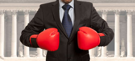 attorney: Legal concept. The lawyer in red boxing gloves