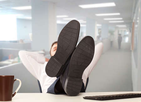 weary: Weary businessman sitting in a chair, and solves the problem