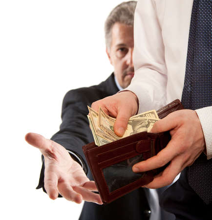 bribe: Businessman taking bribe over white background.  Business concept