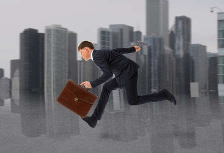nimble: Businessman running with a briefcase. Business concept