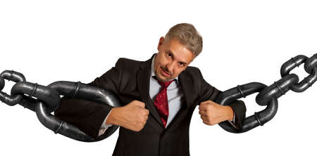 helplessness: Businessman with several sections of huge chain over white background