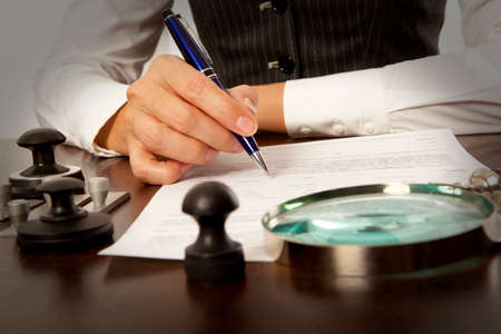 lawyer office: Woman notary, lawyer signs the documents in office