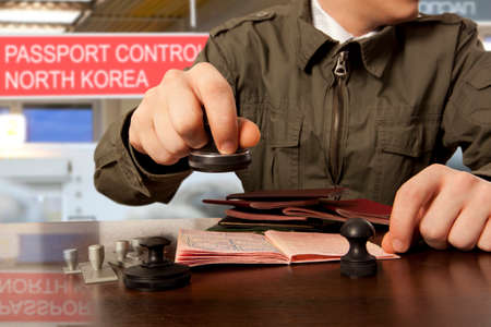 Officer of the state border guard service of North Korean. Passport control. Stock Photo