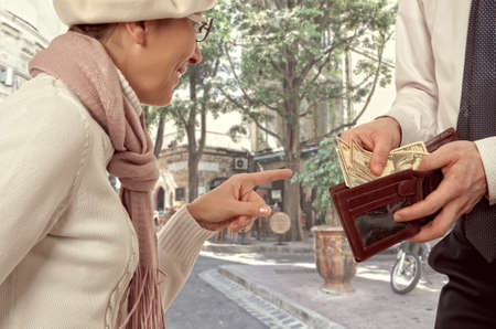 benevolence: Wealthy businessman gives a woman the money. Vintage style