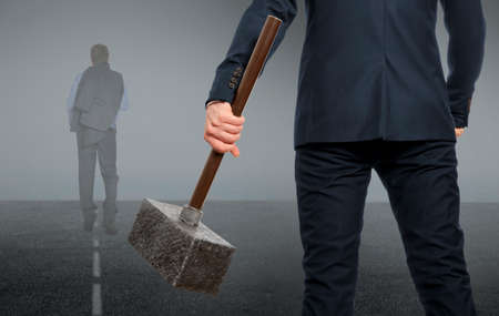 destroying the competition: Determined businessman with hammer in hands. Business concept. Stock Photo