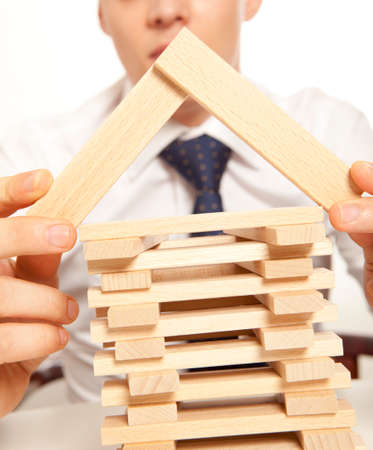 inventor: Inventor.  Businessman building tower of wooden blocks Stock Photo