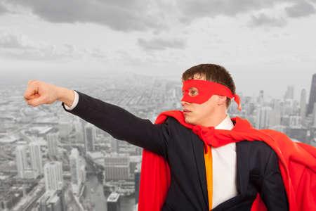cloak: Businessman superhero in a red cloak. Business concept.