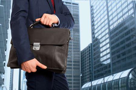 briefcase: Portfolio investor. Businessman with briefcase