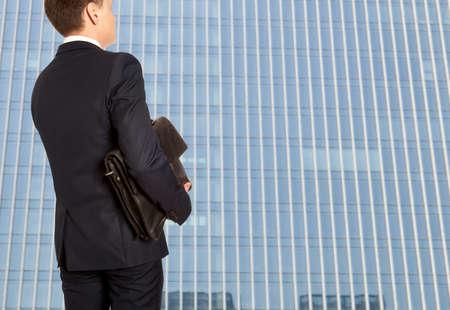 capitalist: Portfolio investor. Businessman with briefcase