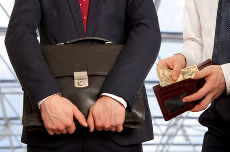 lend a hand: Businessman taking bribe.  Business concept