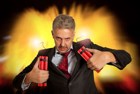 detonating: Crazy businessman holding explosive bomb.  Concept business competition Stock Photo