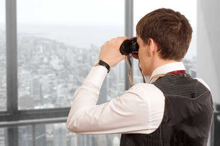 Business concept. Businessman looks through a binoculars Stock Photo
