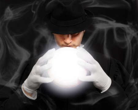 conjuring: Magician in top hat showing trick. Magic, performance, circus, show concept. Soft focus