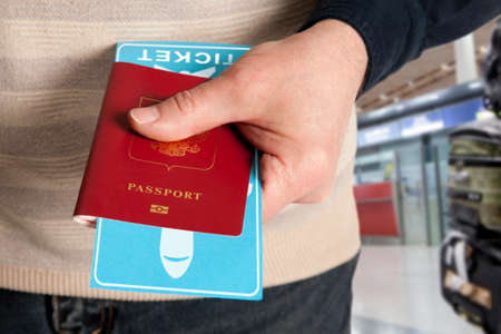airport check in counter: Customs control. Passport and ticket in hand in airport