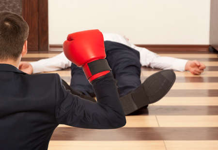 knockout: Business knockout. Businessman in red boxing gloves
