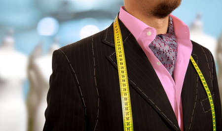 measured: Luxury tailor concept.  Businessman getting measured by a tailor