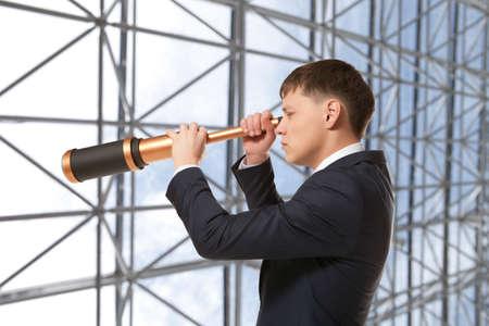 trailblazer: Business concept. Businessman looks through a telescope
