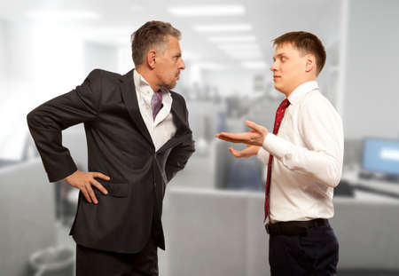 mitigate: Business competition, conflict concept. Two businessman are trying to come to an agreement