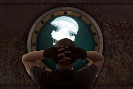 armoring: Captain looks out the window of the submarine Stock Photo