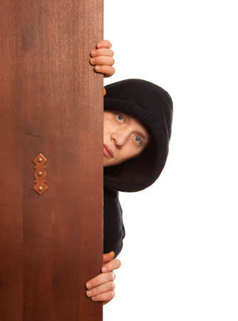 felon: Ninja. Robber hiding behind a wooden doors with space for text