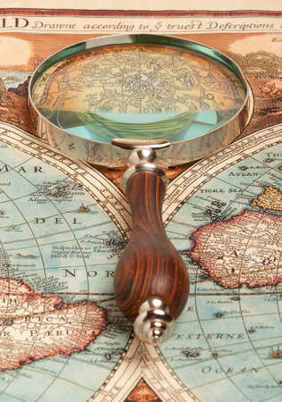 globetrotter: Magnifying glass and ancient old map