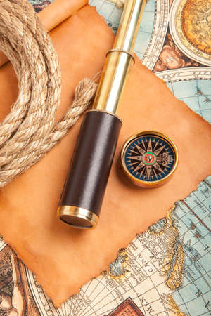 antique: Vintage brass telescope on old antique map