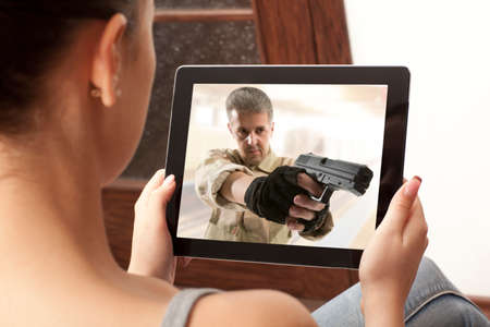 action movie: Cropped image of woman looking at action movie on tablet Stock Photo