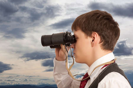 trailblazer: Business concept. Businessman looks through a binoculars Stock Photo