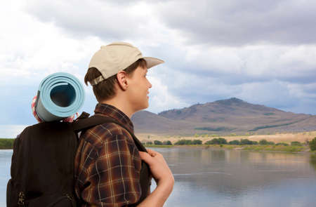 man waterfalls: Young man with a travel backpack Stock Photo